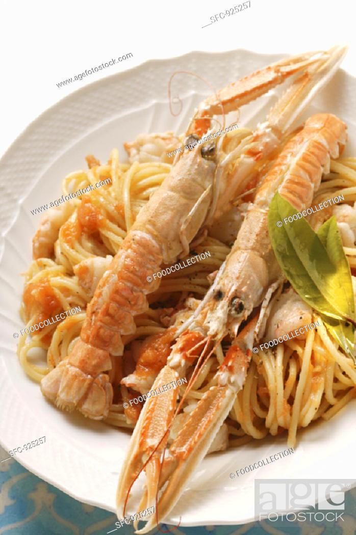 Stock Photo: Spaghetti with scampi and tomato sauce.