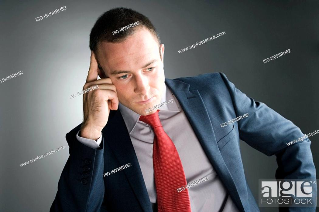 Stock Photo: Thoughtful looking businessman.