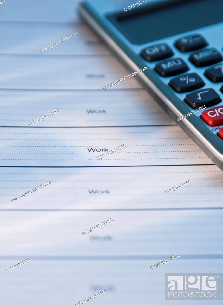 Stock Photo: Close up of datebook and calculator.