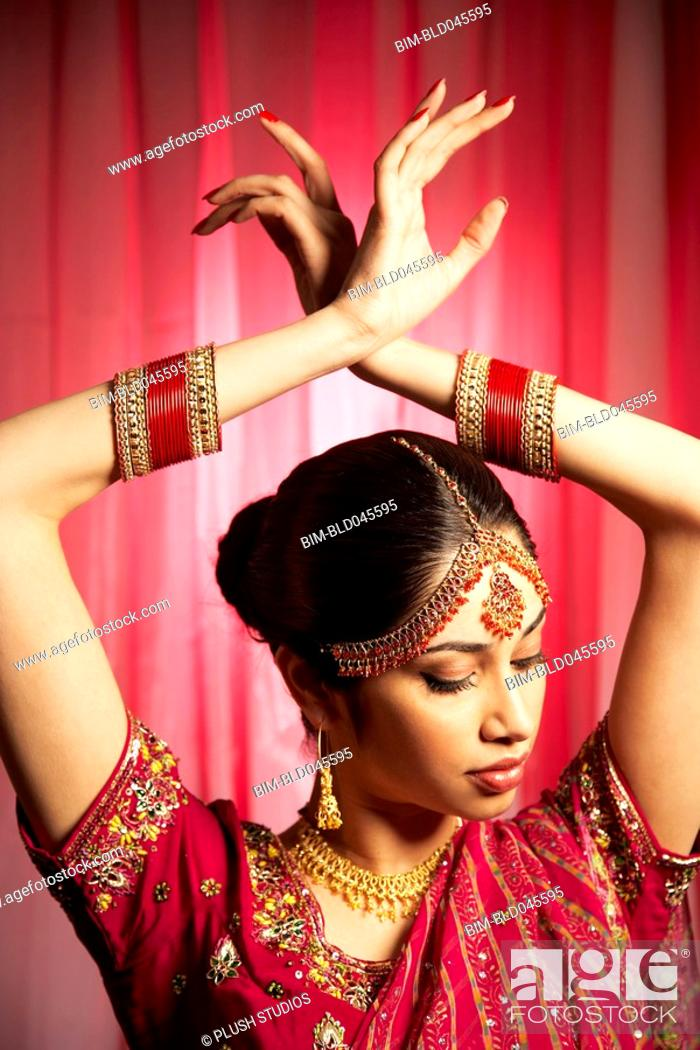 Stock Photo: Indian woman with hands over head.