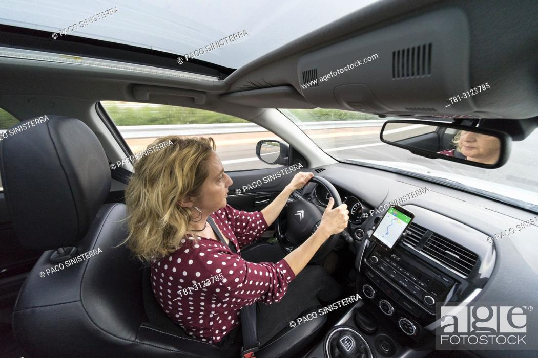 Stock Photo: woman driving on the Alcocebre highway, Castellon, Spain.