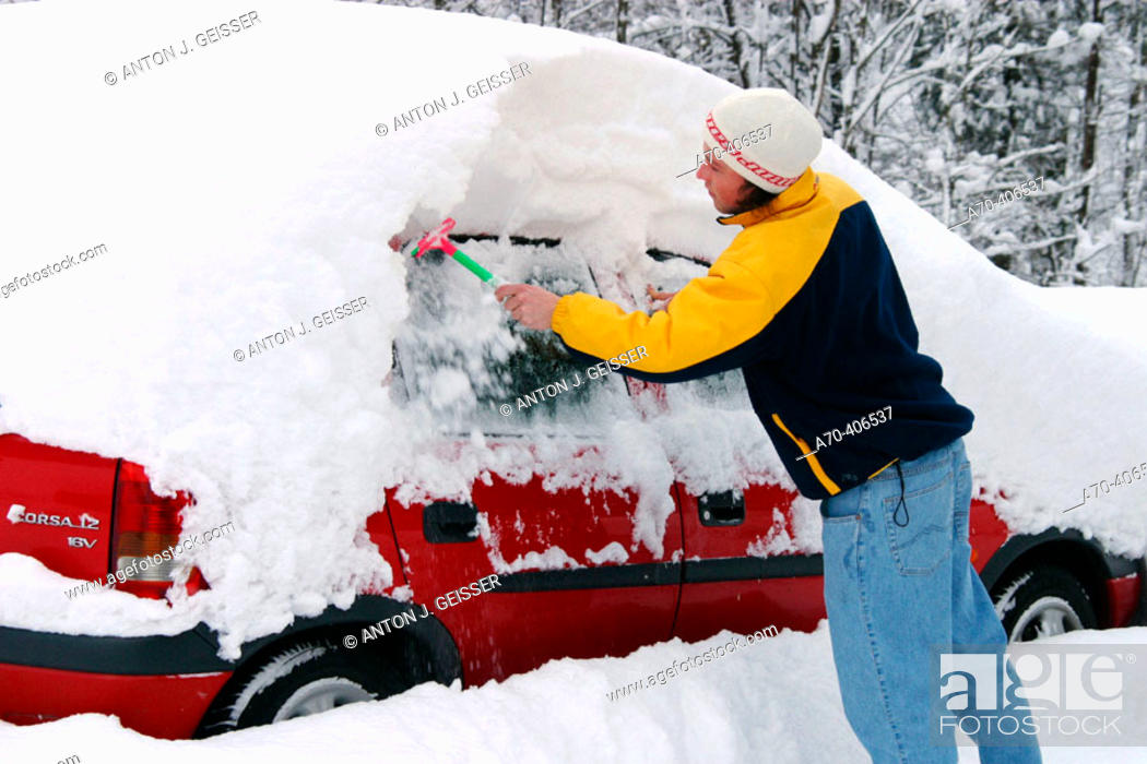 Stock Photo: Removing snow from car.