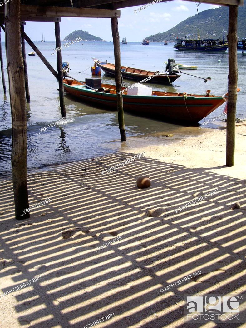 Stock Photo: Boats under the timber pier in Koh Tao, Thailand under the timber pier in Koh Tao, Thailand.