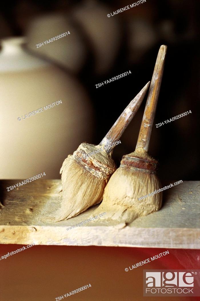 Stock Photo: Potter's brushes on shelf.