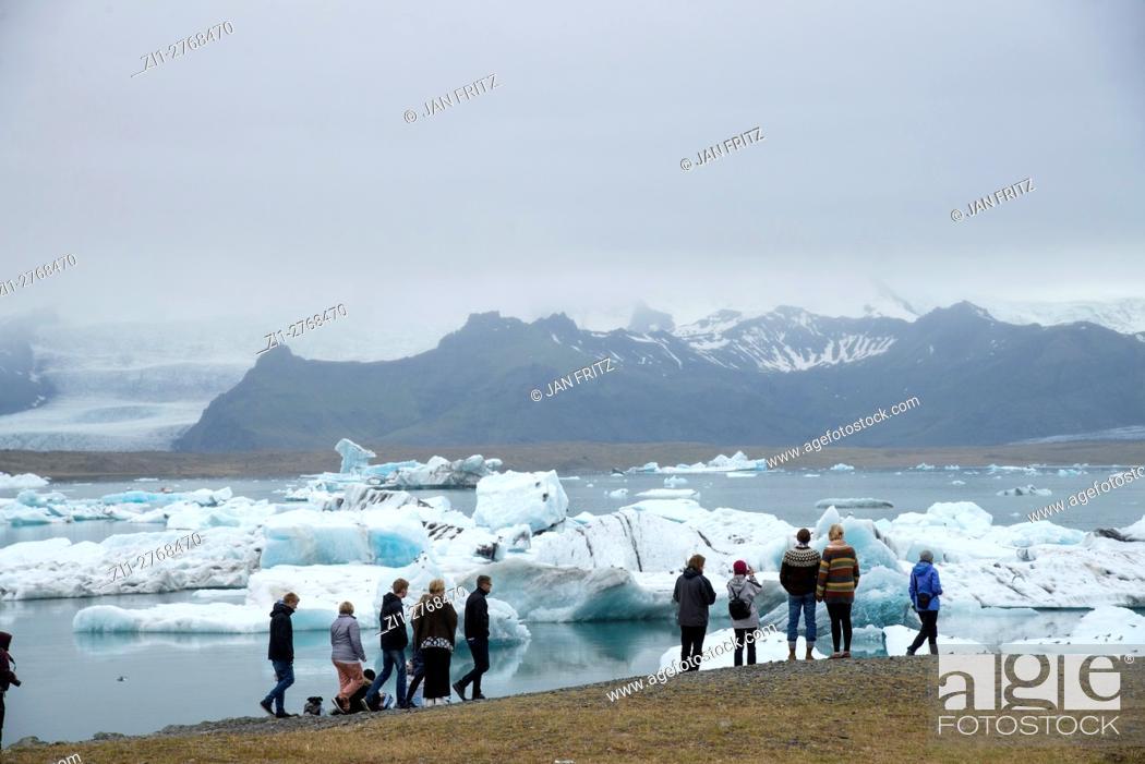 Stock Photo: tourists at Jokulsarlon glacier lake in Iceland.