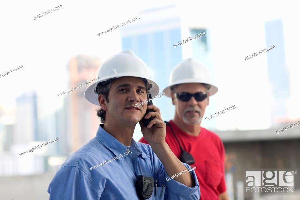 Stock Photo: Close-up of two male construction workers at a construction site.