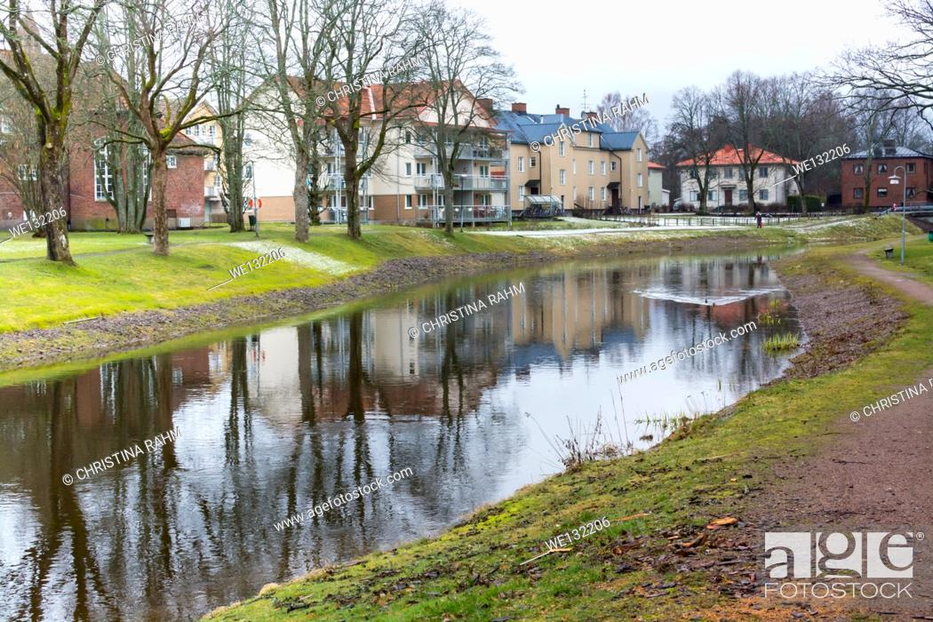 Stock Photo: Amal River - Åmålsån - running through the small city of Amal, Varmland, Sweden in March.