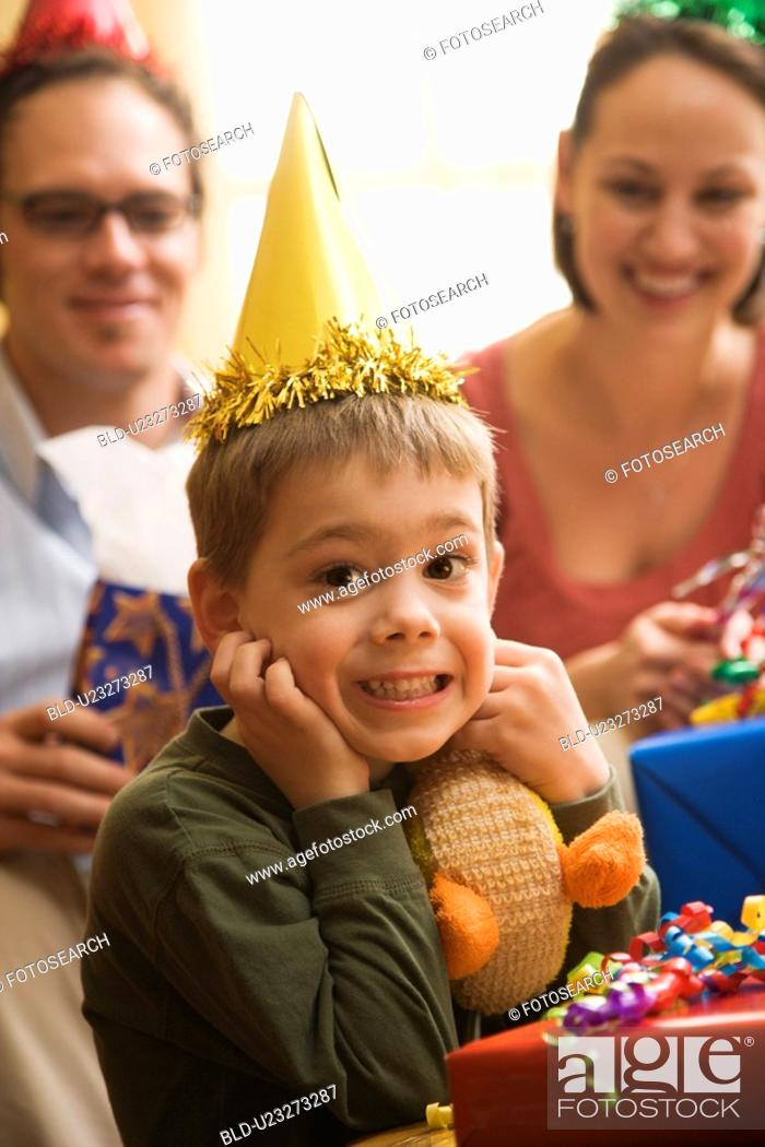 Stock Photo: Caucasian boy at birthday party looking at viewer making facial expression.