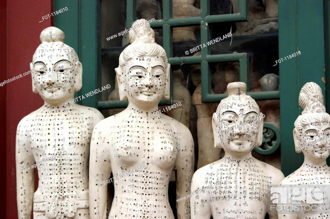 Stock Photo: Acupuncture statues at Panjiayuan Antique Market, Beijing, China.