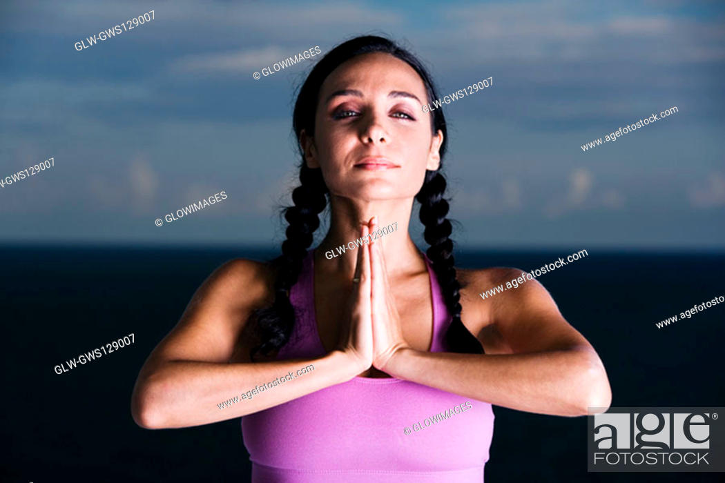 Stock Photo: Portrait of a young woman meditating.