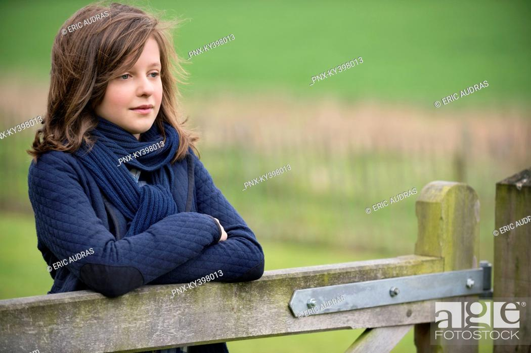 Stock Photo: Girl thinking in a farm.