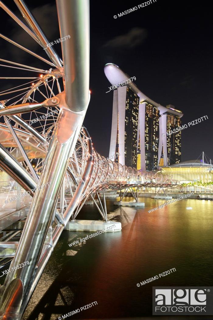 Stock Photo: The Helix bridge and the Marina Bay Sand Hotel, Singapore.
