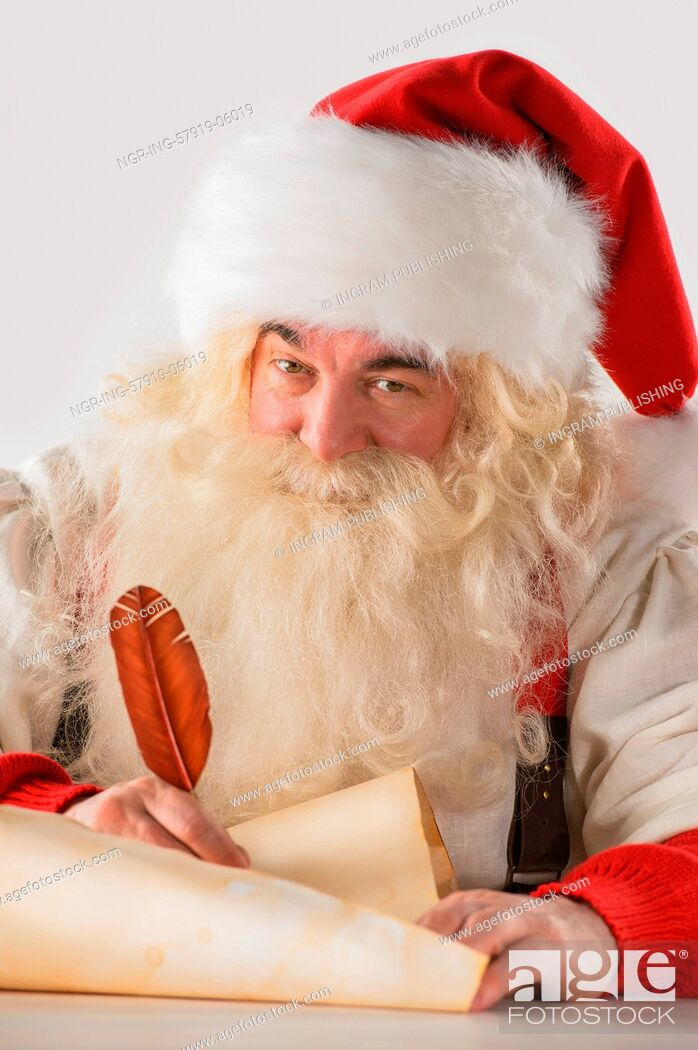 Stock Photo: Real Santa Claus writing list of gifts or responding to children's letters on old paper scroll, isolated on white background.
