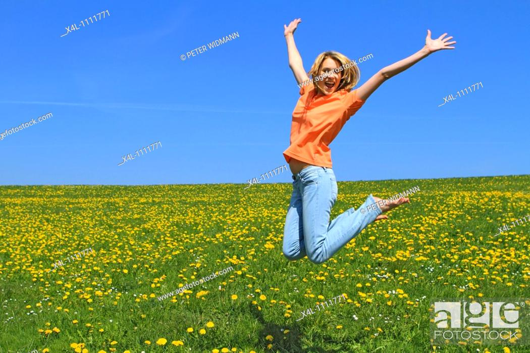 Stock Photo: Happy young woman in spring.