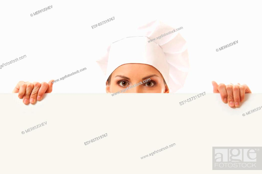 Imagen: Woman cook looking over paper sign billboard. Isolated on white.