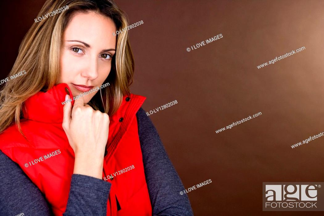 Stock Photo: Portrait of a mid adult woman wearing a red gilet.