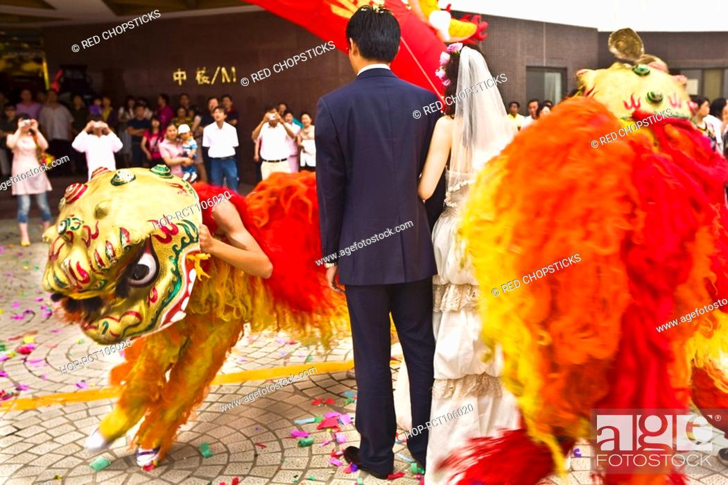 Stock Photo: Rear view of a newlywed couple in a traditional ceremony, Qingdao, Shandong Province, China.