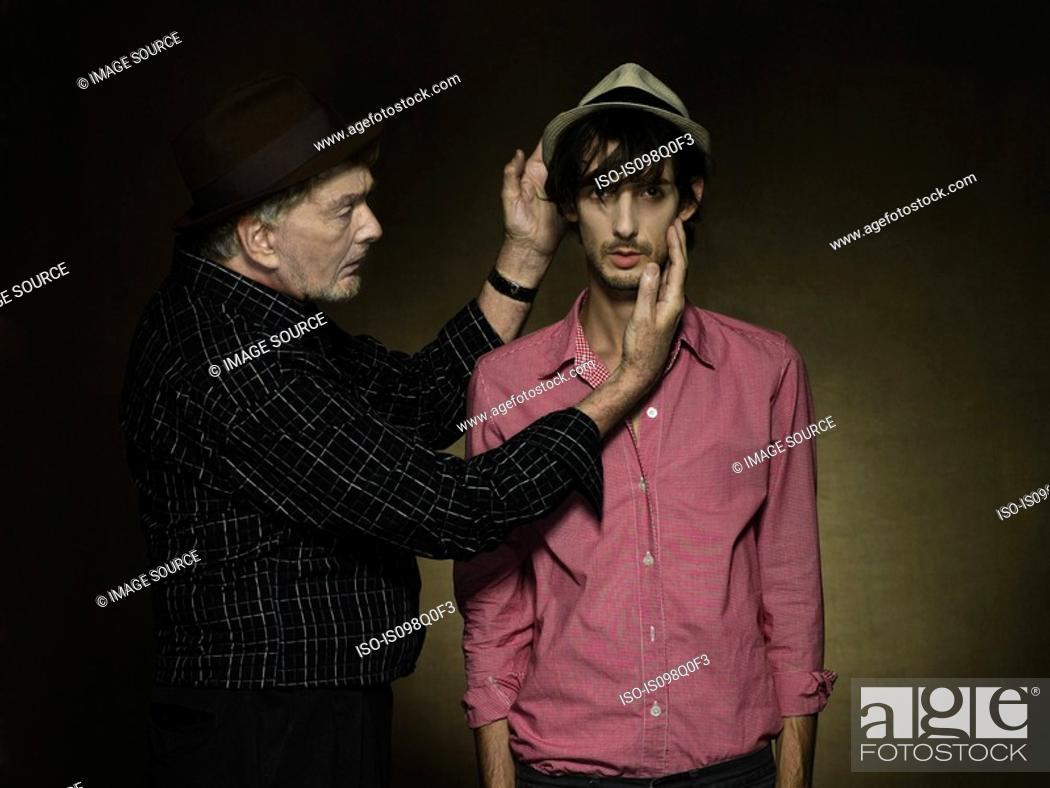 Stock Photo: A senior man looking at a young man.