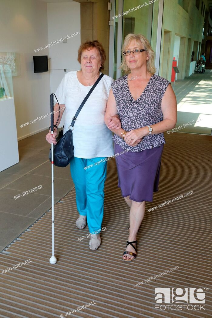 Stock Photo: Woman with visual impairments with helper at the Yorkshire Sculpture Park.