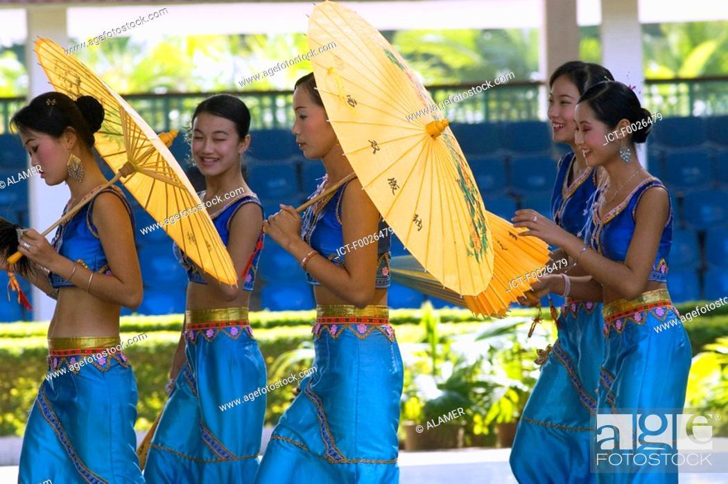 Stock Photo: China, Yunnan, Xishuangbanna, near Jinghong, Dai Minority Park, young Dai dancers.