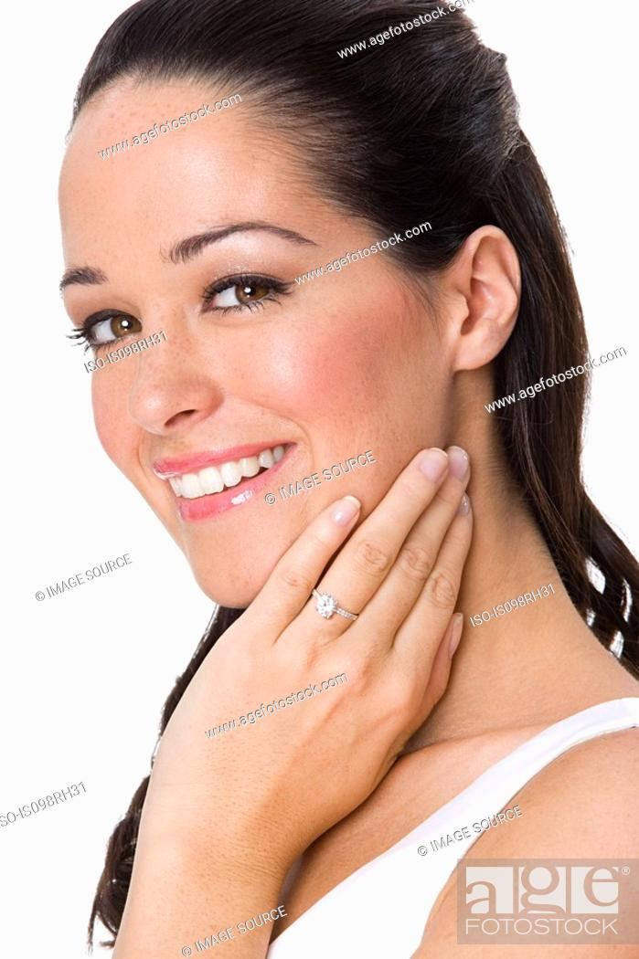 Stock Photo: Smiling woman wearing an engagement ring.