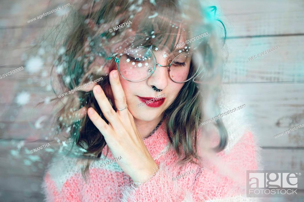 Stock Photo: Portrait of beautiful woman wearing nose ring and glasses.