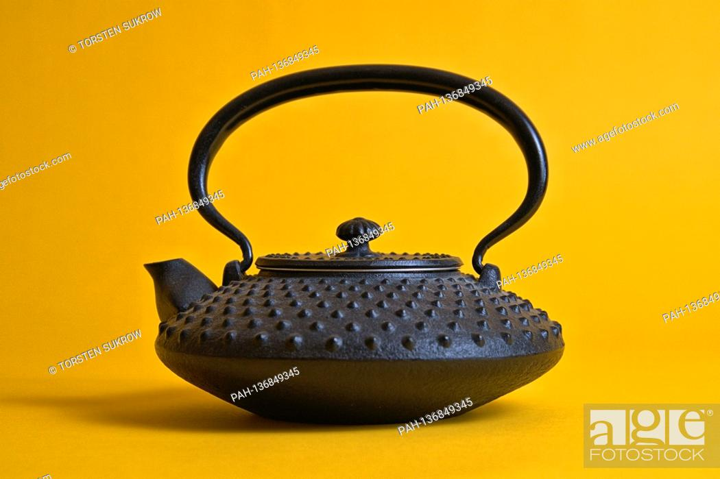Stock Photo: A small original Iwachu cast iron teapot from Japan with the so-called, hail pattern (Arare), here in smaller size (Chu-Arare).