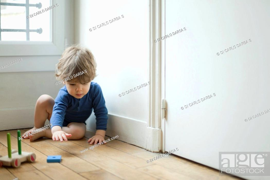 Stock Photo: Toddler boy playing with toy.