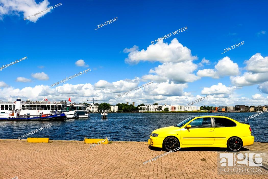 Stock Photo: Yellow car at the Ij in Amsterdam, Holland, Europe.
