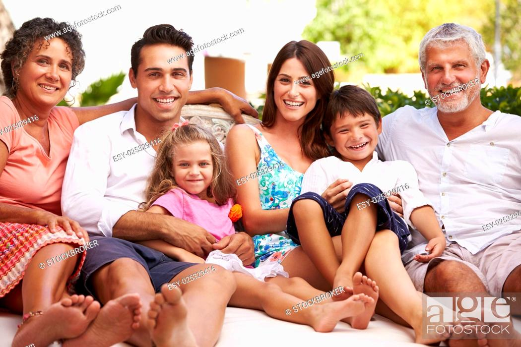 Stock Photo: Multi Generation Family Sitting Outdoors At Home Together.