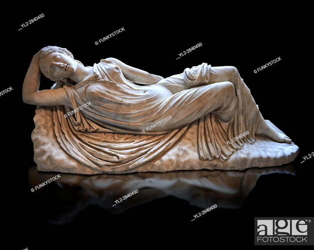 Stock Photo: Ariadne sleeping a 2nd century AD Marble Roman statue from Italy. The girl is lying asleep on a rock and is a variation of the famous Sleeping Ariadne of the.