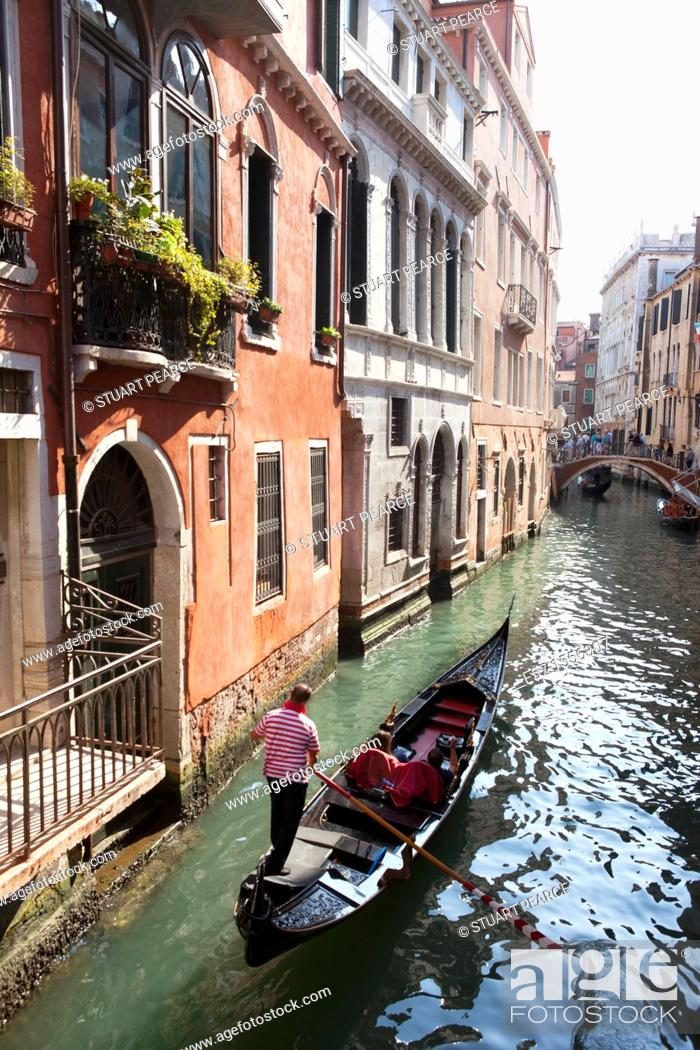 Stock Photo: Gondolas on the narrow canals of Venice, Italy.