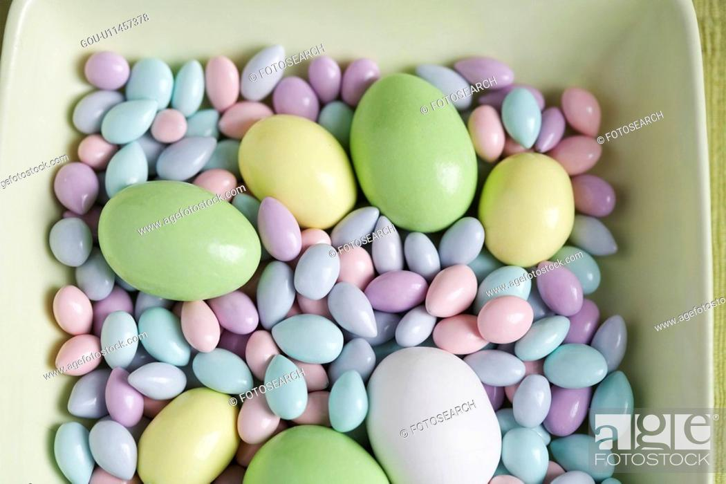 Stock Photo: Easter eggs and candies in bowl (close-up, high angle view).