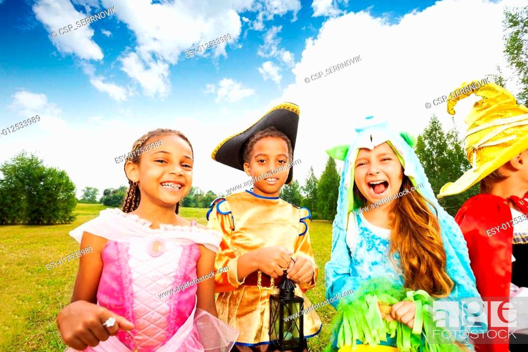 Stock Photo: Kids dressed wearing Halloween costumes in park.
