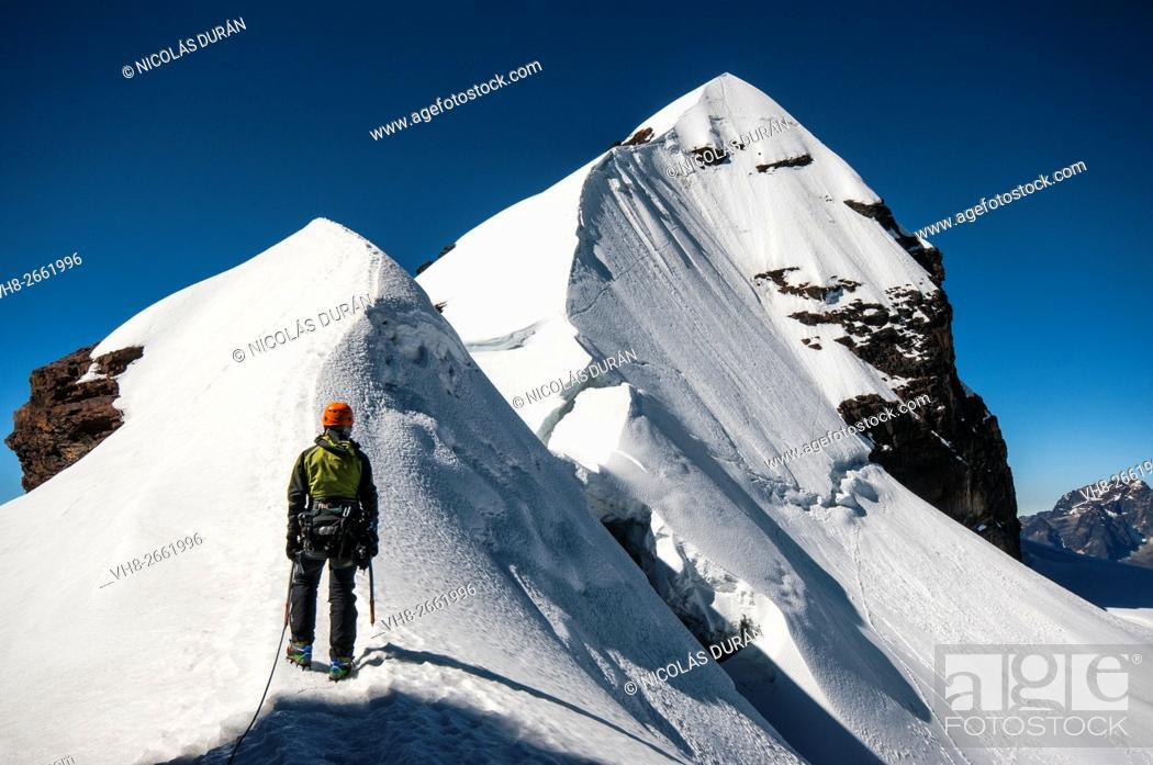 Stock Photo: Climber arriving Pequeño Alpamayo summit. Cordillera Real range, Andes. Bolivia. South America.