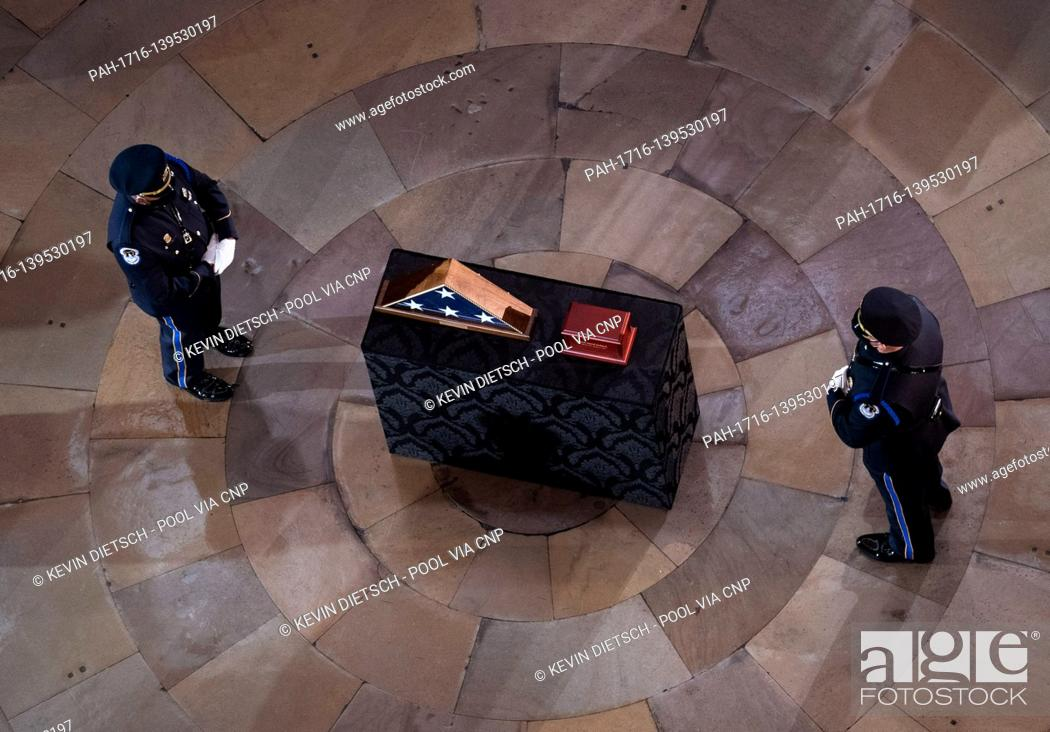 Stock Photo: Capitol Hill Police Officer Brian Sicknick lies in honor in the Rotunda of the U.S. Capitol Building in Washington, DC on Tuesday, February 3, 2021.