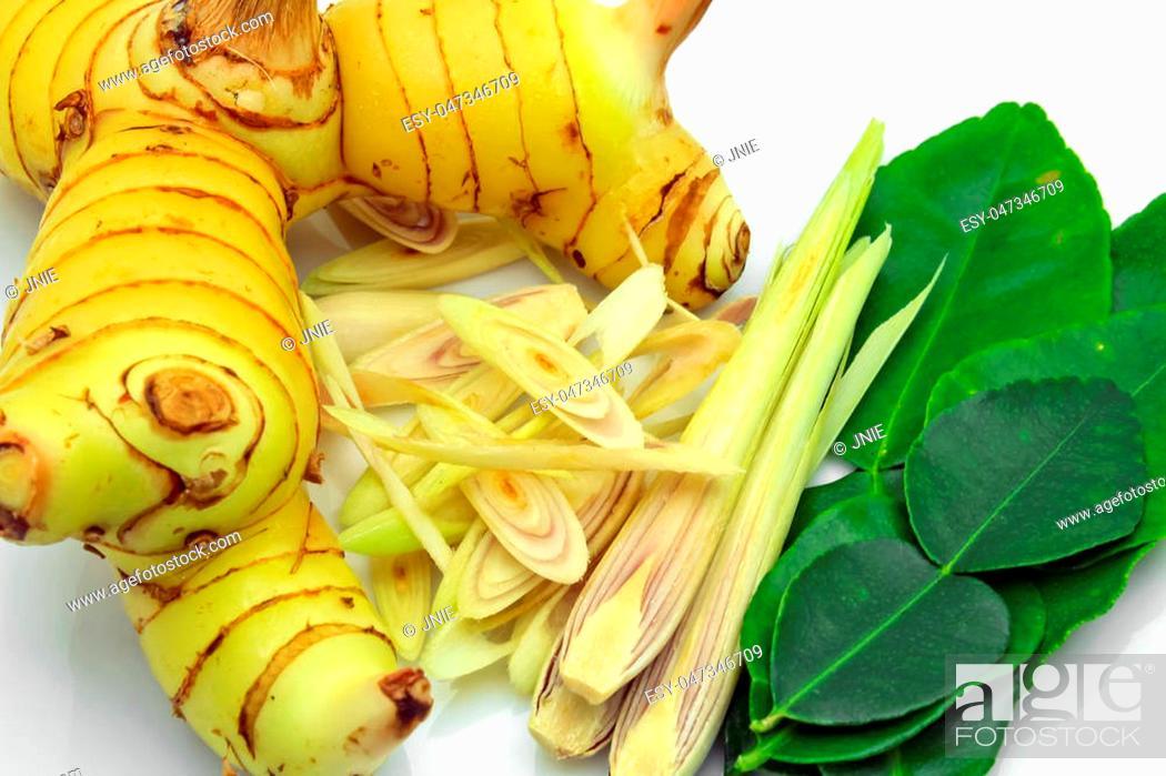 Stock Photo: Galanga, lemon grass and kaffir lime leaf on white background.