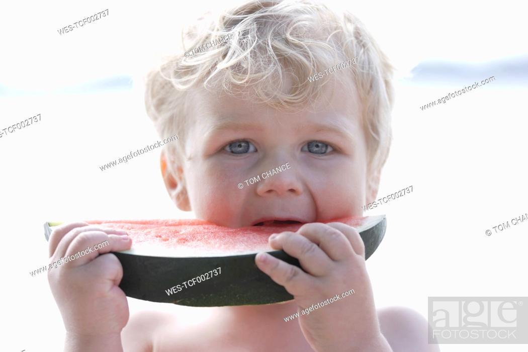 Stock Photo: Germany, Bavaria, Boy eating watermelon, close up.