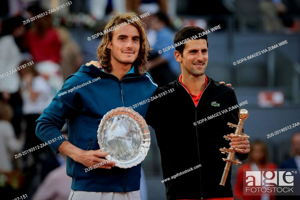 Stock Photo: May 12, 2019 - Madrid, Madrid, Spain - Stefanos Tsitsipas from Greece and Novak Djokovic from Serbia are seen after the Mutua Madrid Open Masters final match on.