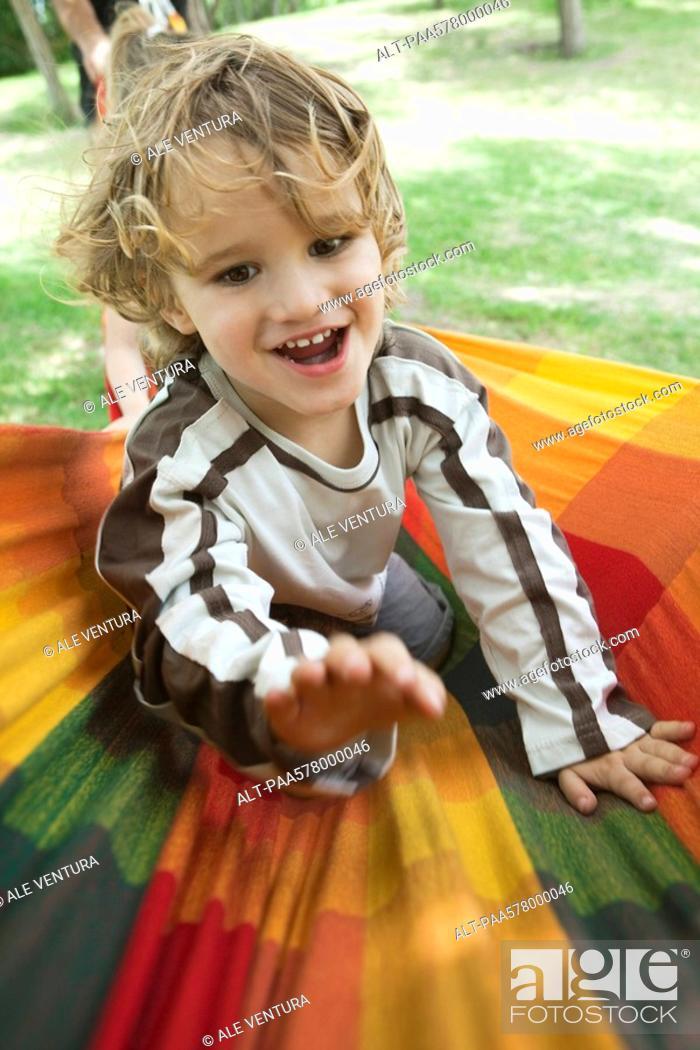Stock Photo: Little boy having fun outdoors, portrait.