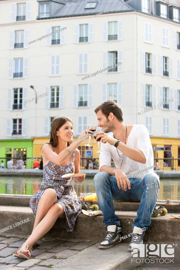 Stock Photo: Couple toasting with wineglasses, Paris, Ile-de-France, France.