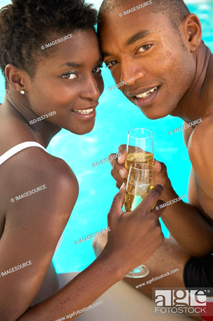 Stock Photo: Couple toasting with champagne.