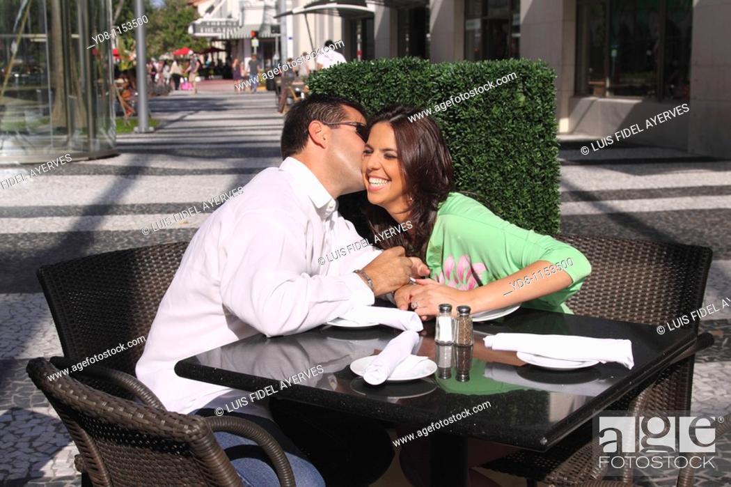 Stock Photo: Couple kissing in lincoln road Miami Beach.