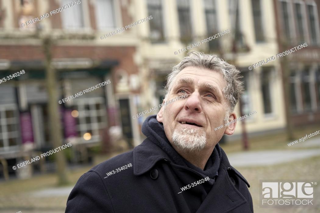Imagen: curious senior man peering up in Workum, Friesland, Netherlands.