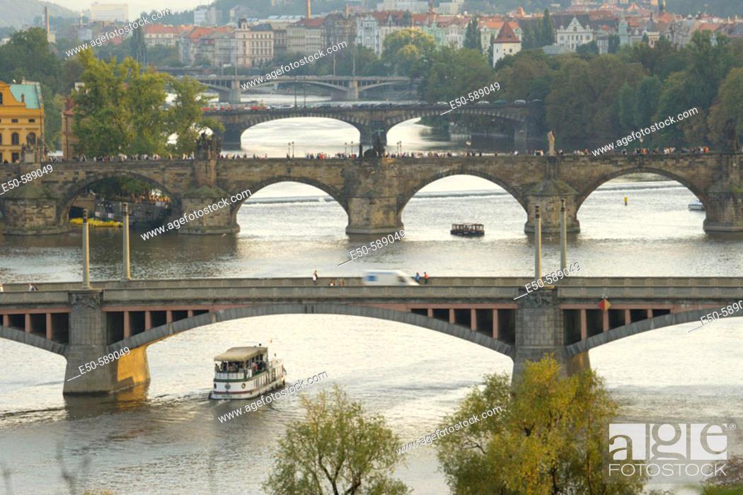 Stock Photo: View across Vltava River to Old Town Bridge Tower area, Prague, Czech Republic.