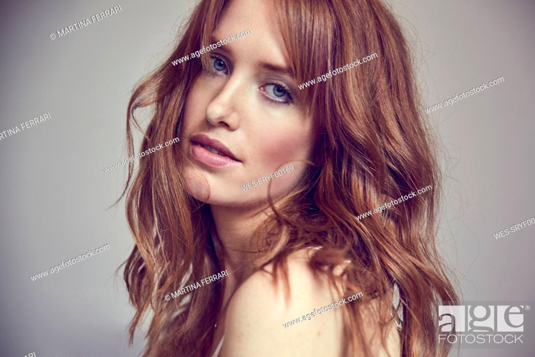 Stock Photo: Portrait of lascivious redheaded woman.