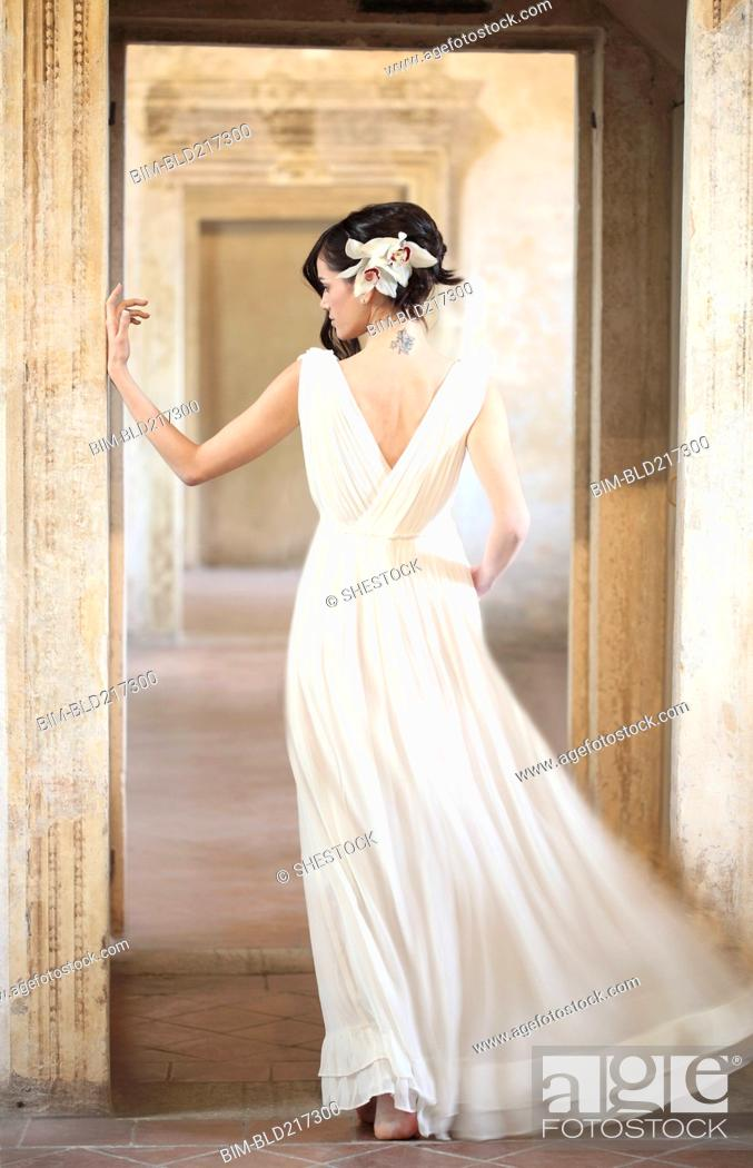 Stock Photo: Caucasian woman wearing evening gown.