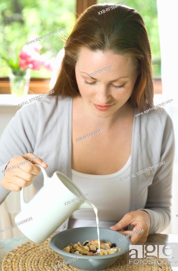 Stock Photo: woman eating muesli.