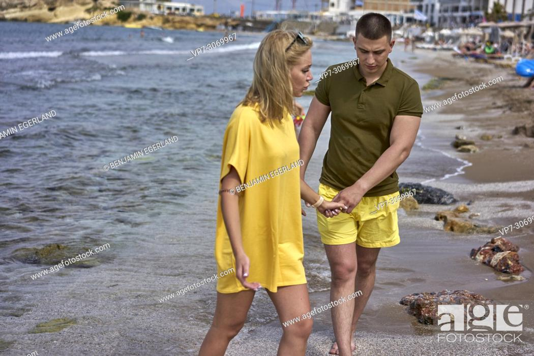Stock Photo: Young couple on the beach, Russian ethnicity, Hersonissos, Crete, Greece.