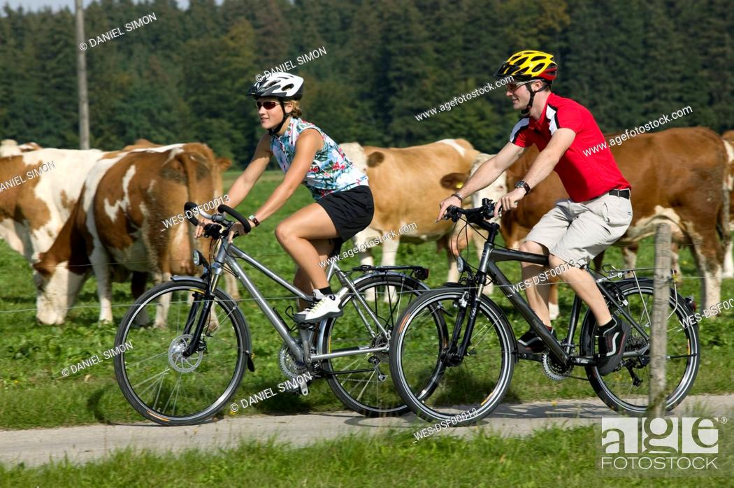 Stock Photo: Germany, Bavaria, Tegernsee, Couple mountain biking.